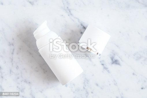 istock White bottle of cosmetic product on white marble table 846116204