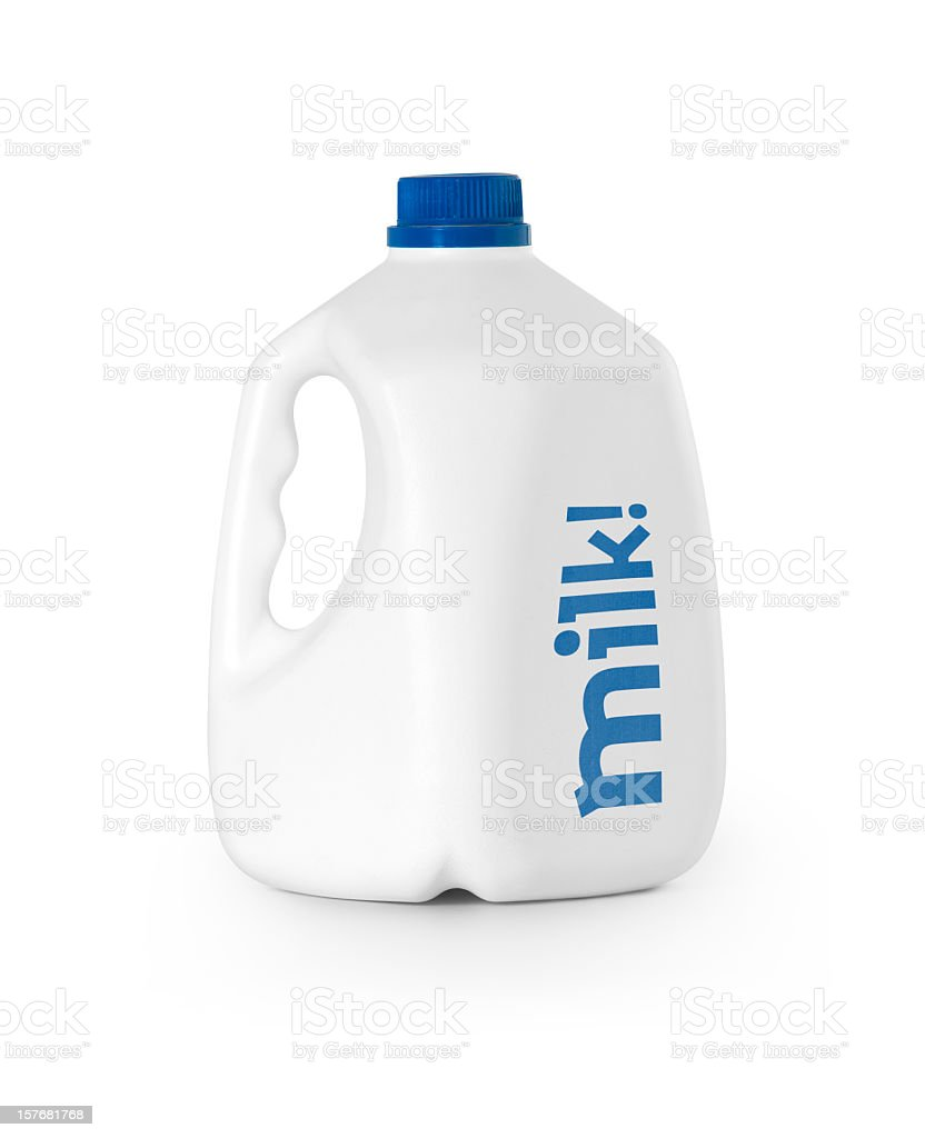 A white bottle of milk with blue lid royalty-free stock photo