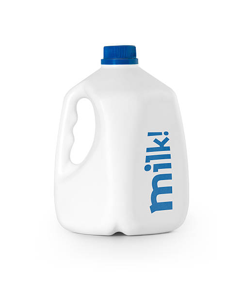 A white bottle of milk with blue lid Milk bottle isolated with clipping path. gallon stock pictures, royalty-free photos & images