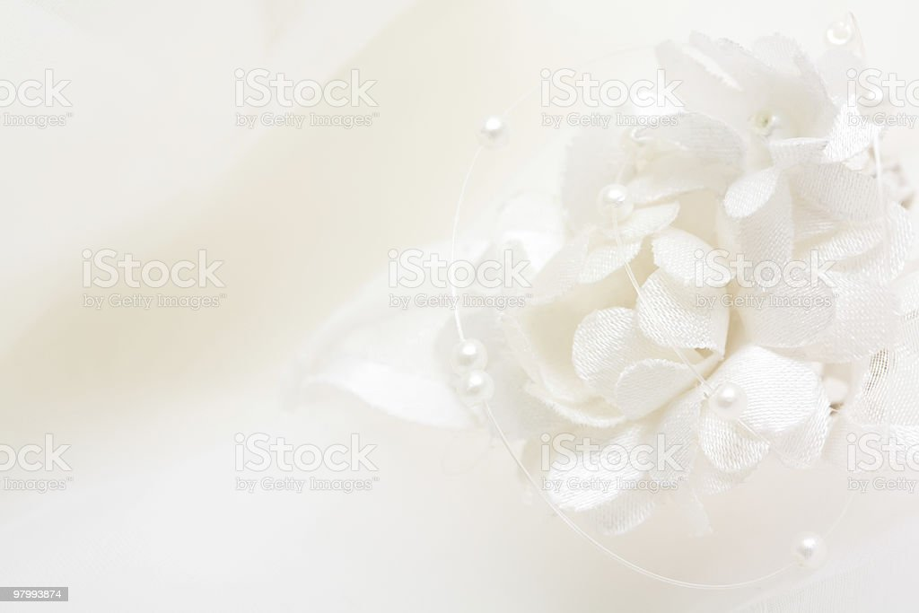 White bouquet with strings of pearls on a white background  royalty-free stock photo
