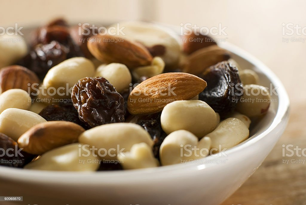 White bowl filled with shelled mixed nuts royalty-free stock photo