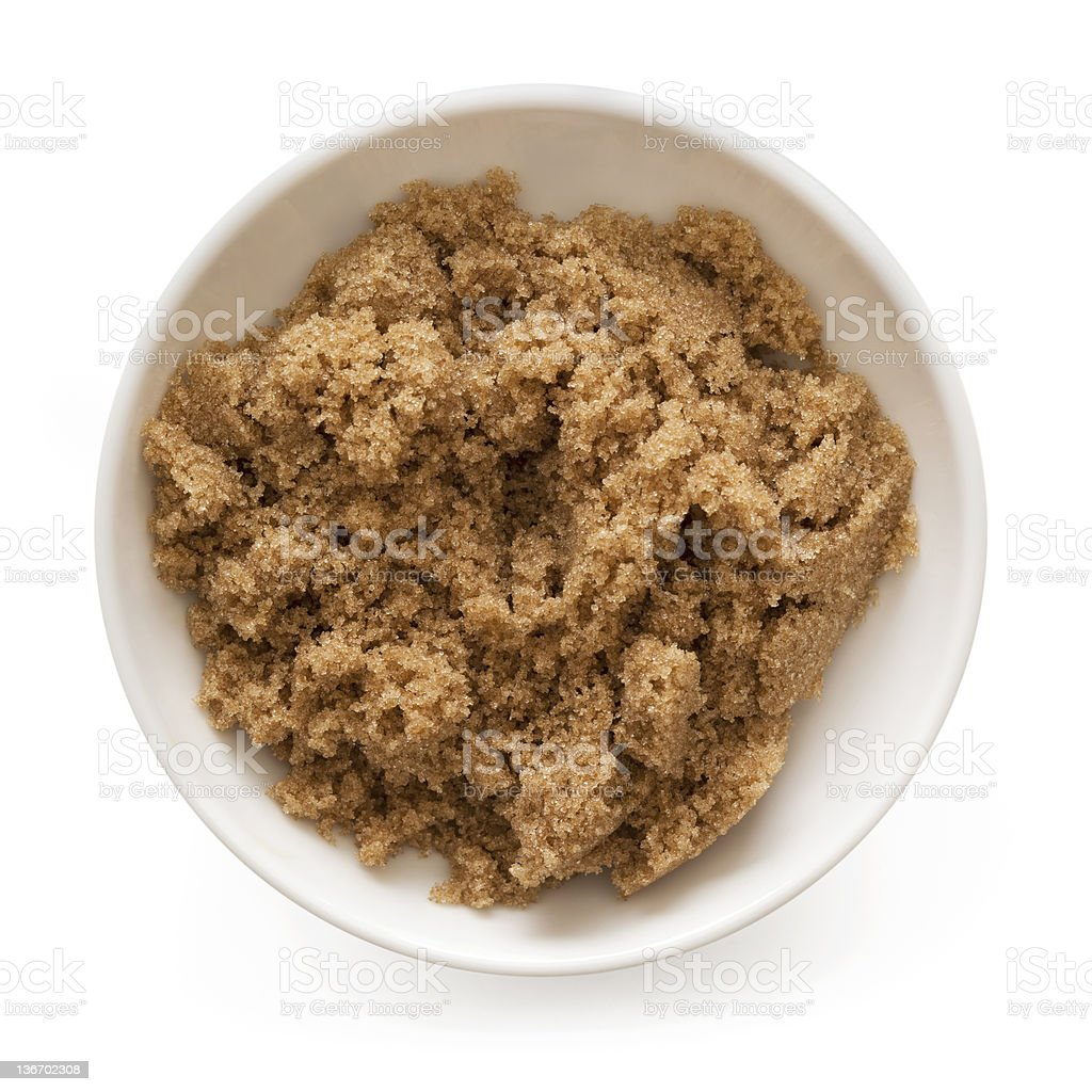 A white bowl of brown sugar on a white background stock photo