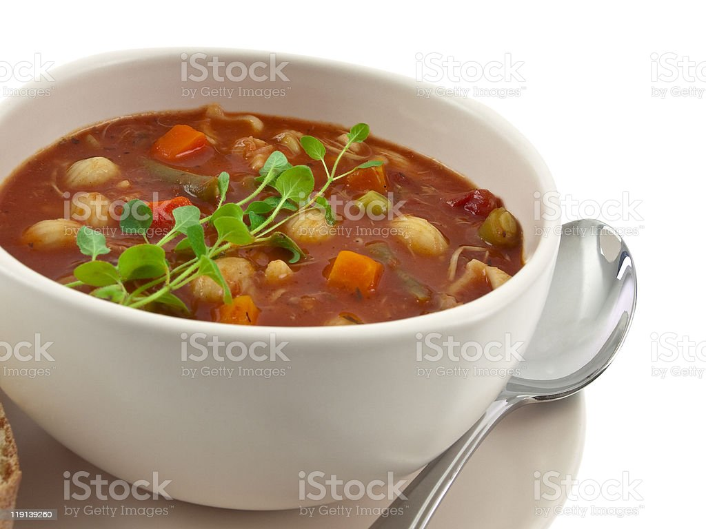 White bowl of soup with spoon  stock photo