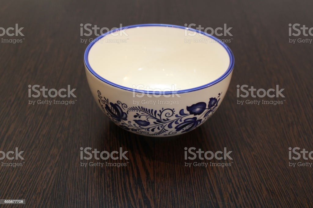White bowl with blue flowers stock photo