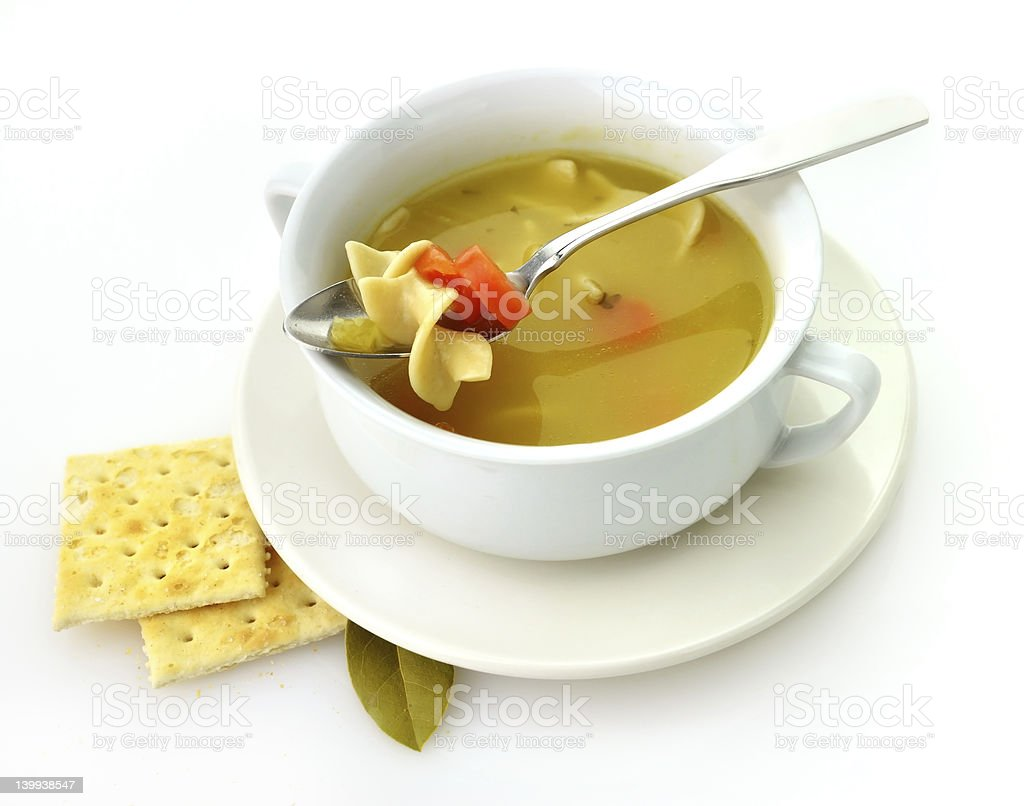 White bowl with chicken noodle soup and a side of crackers royalty-free stock photo
