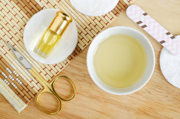 white bowl with olive oil, small bottle of essential oil, scissors and nail file for natural nails and cuticle treatment. homemade manicure and pedicure concept. top view, opy space. - cuticle stock pictures, royalty-free photos & images