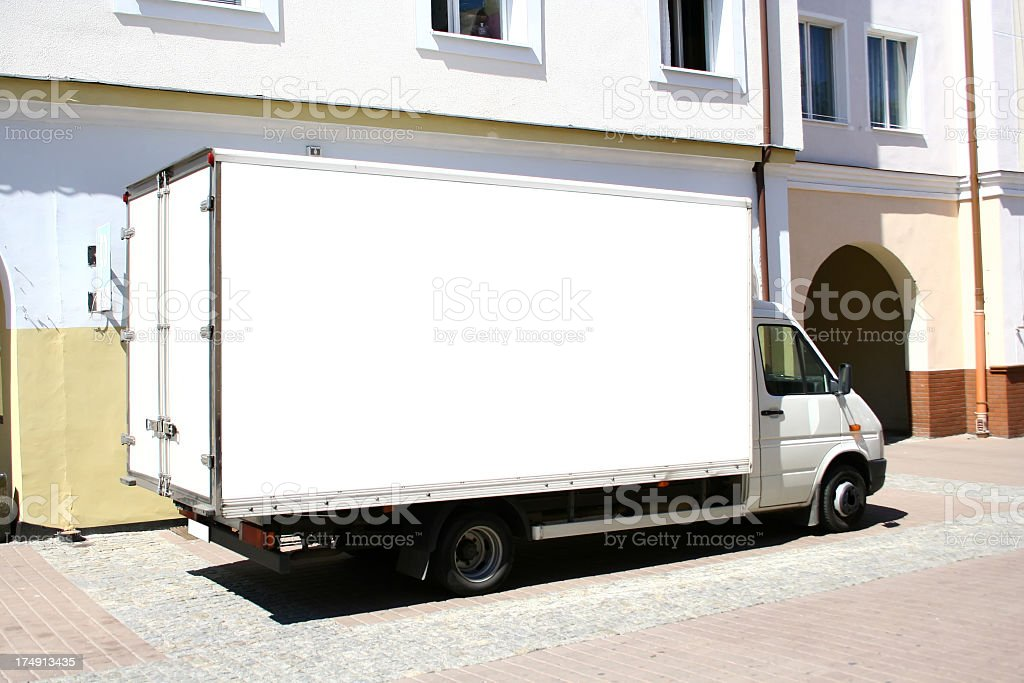 White box truck on quiet side street, in early afternoon  stock photo