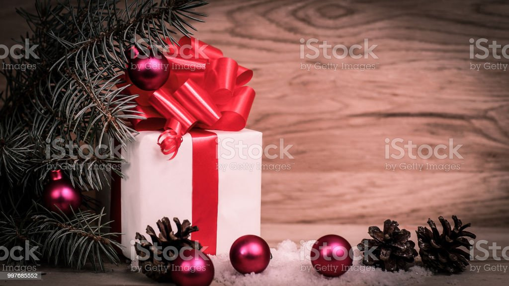 white box with Christmas gift on wooden table.photo with space for...
