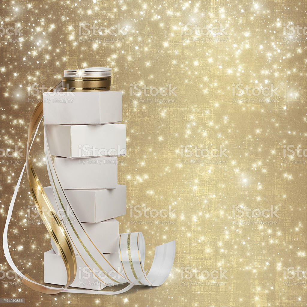 White boxes with gifts with gold ribbon beautiful abstract backg stock photo