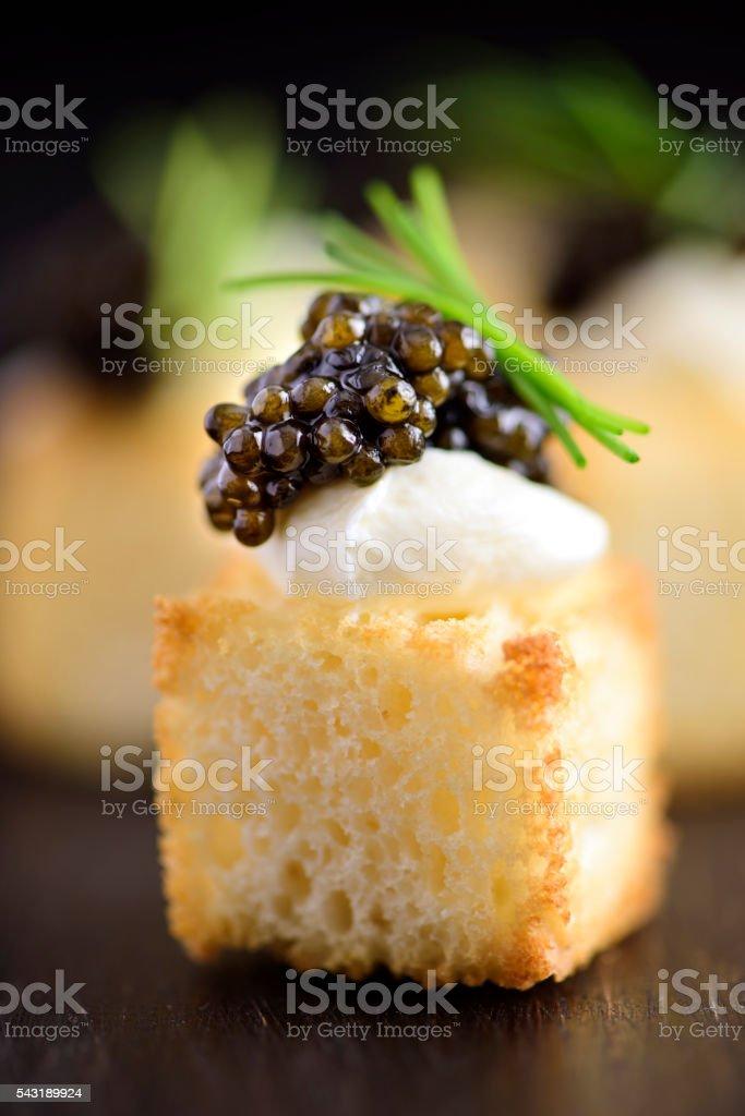 White Bread Cube and Black Caviar Appetizer stock photo