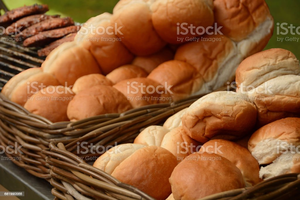 White bread rolls laying in a basket ready to fill. stock photo