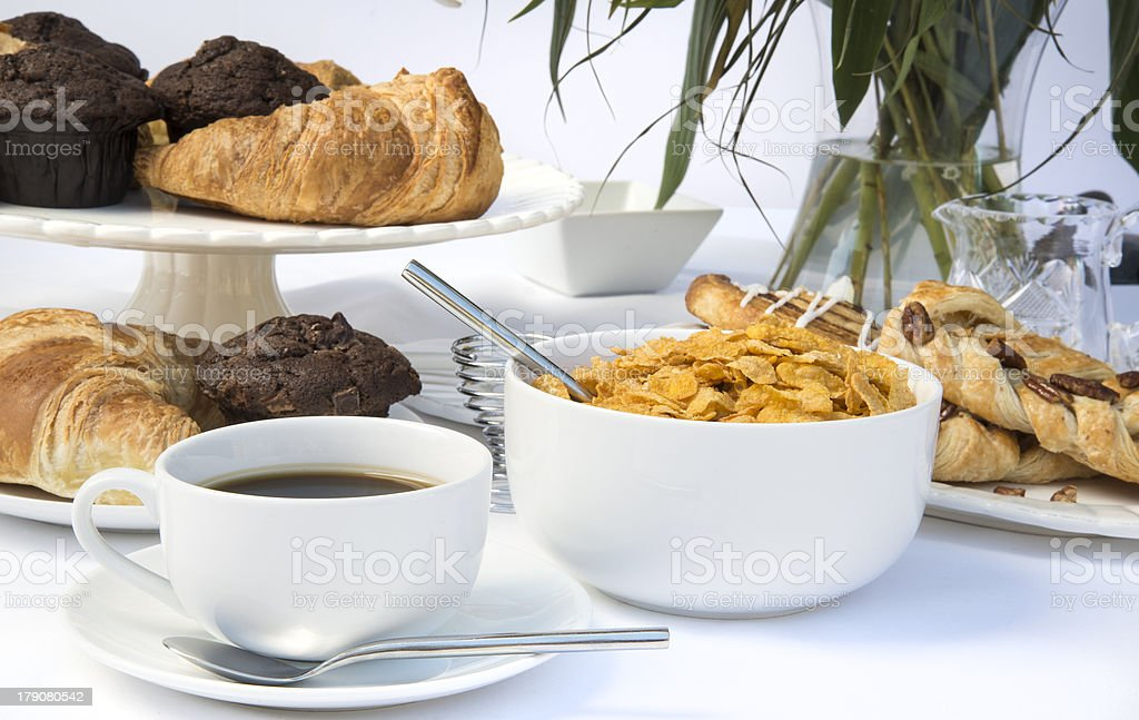White breakfast table setting with lily flowers royalty-free stock photo