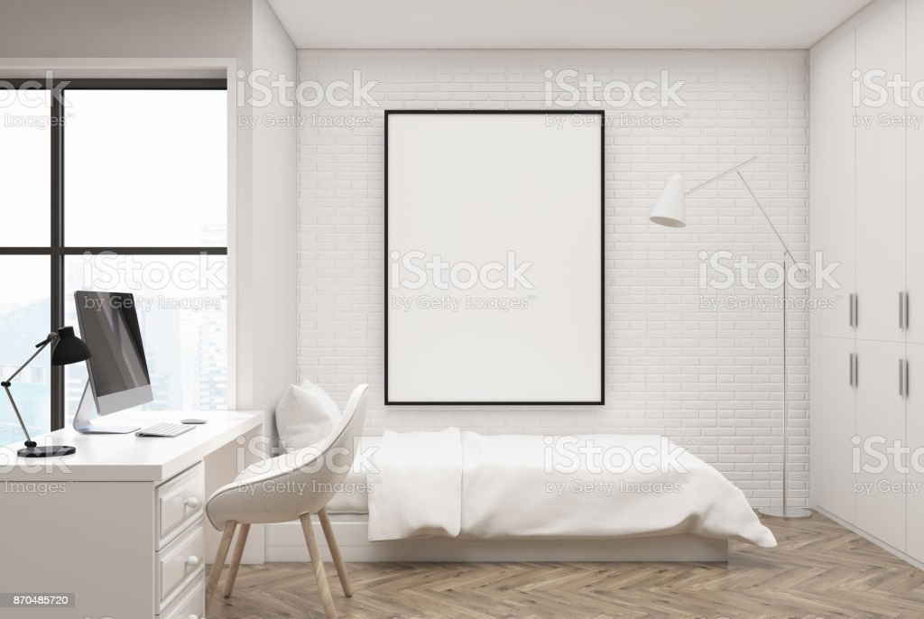 White brick bedroom, computer and poster stock photo