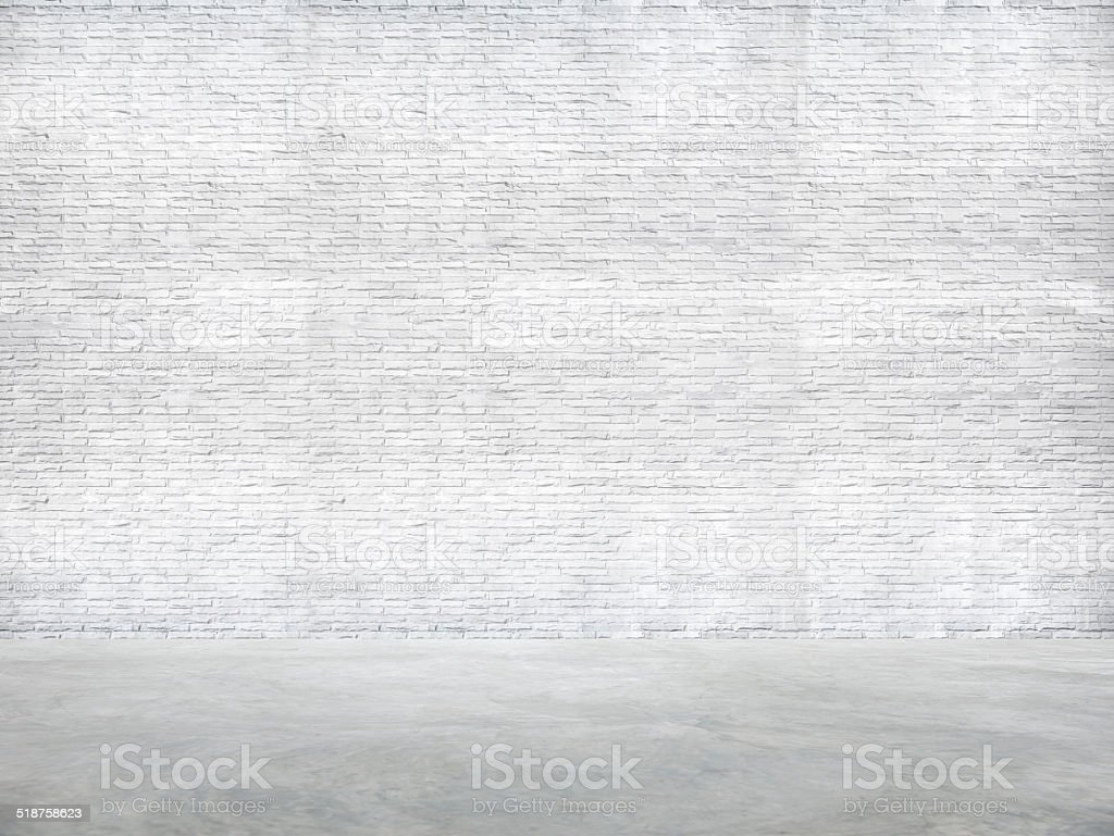 White Brick Wall and Cement Floor stock photo