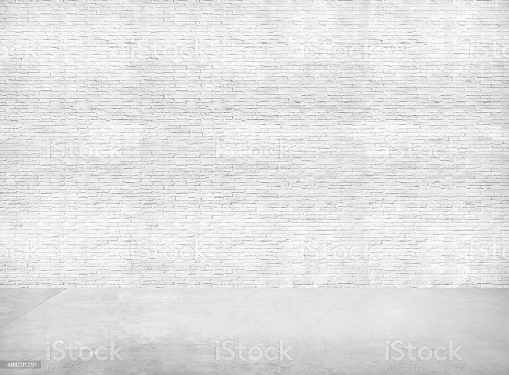 White Brick Wall and Gray Cement Floor for Copy Space stock photo