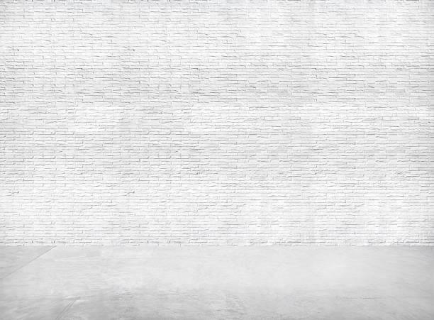 white brick wall and gray cement floor for copy space - versterkte muur stockfoto's en -beelden