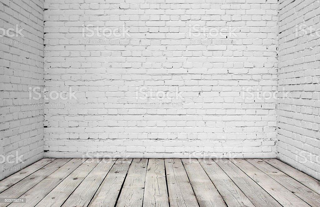 White brick wall and wood floor. stock photo