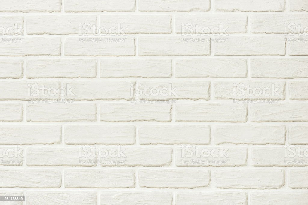 white brick wall background photo, yellow toned foto stock royalty-free