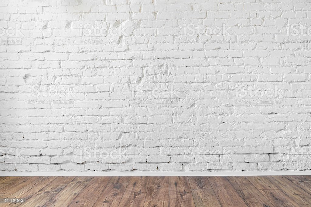 white brick wall background texture wooden floor stock photo more pictures of backgrounds istock. Black Bedroom Furniture Sets. Home Design Ideas