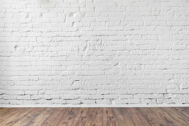 white brick wall background texture wooden floor stock photo