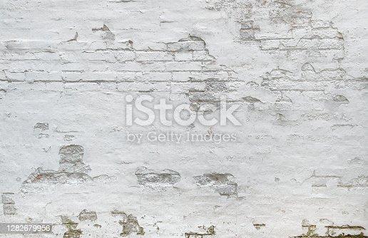istock White brick wall background Weathered plaster 1282679956