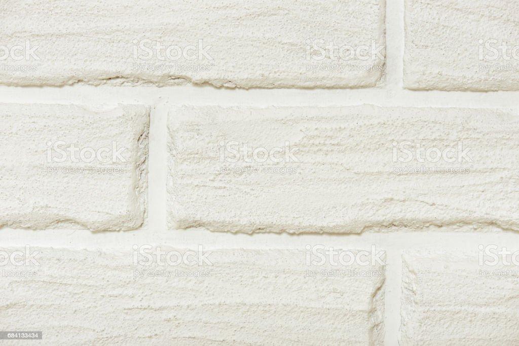 white brick wall closeup background photo, yellow toned foto stock royalty-free