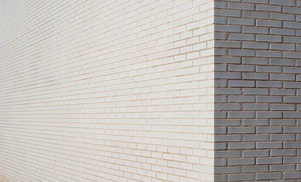 bianco mattoni parete angolo - prospettiva lineare foto e immagini stock