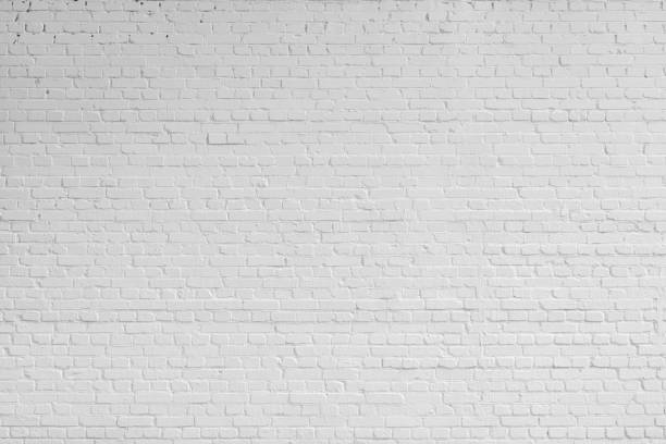 White brick wall. Designer interior background. Abstract architectural surface. brick stock pictures, royalty-free photos & images