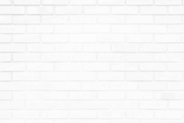 White brick wall texture background. Brickwork or stonework flooring interior rock old pattern clean concrete grid uneven bricks design stack. White brick wall texture background. Brickwork or stonework flooring interior rock old pattern clean concrete grid uneven bricks design stack. subway stock pictures, royalty-free photos & images