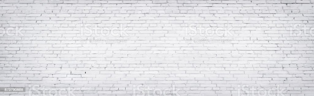 white brick wall, texture of whitened masonry as a background stock photo