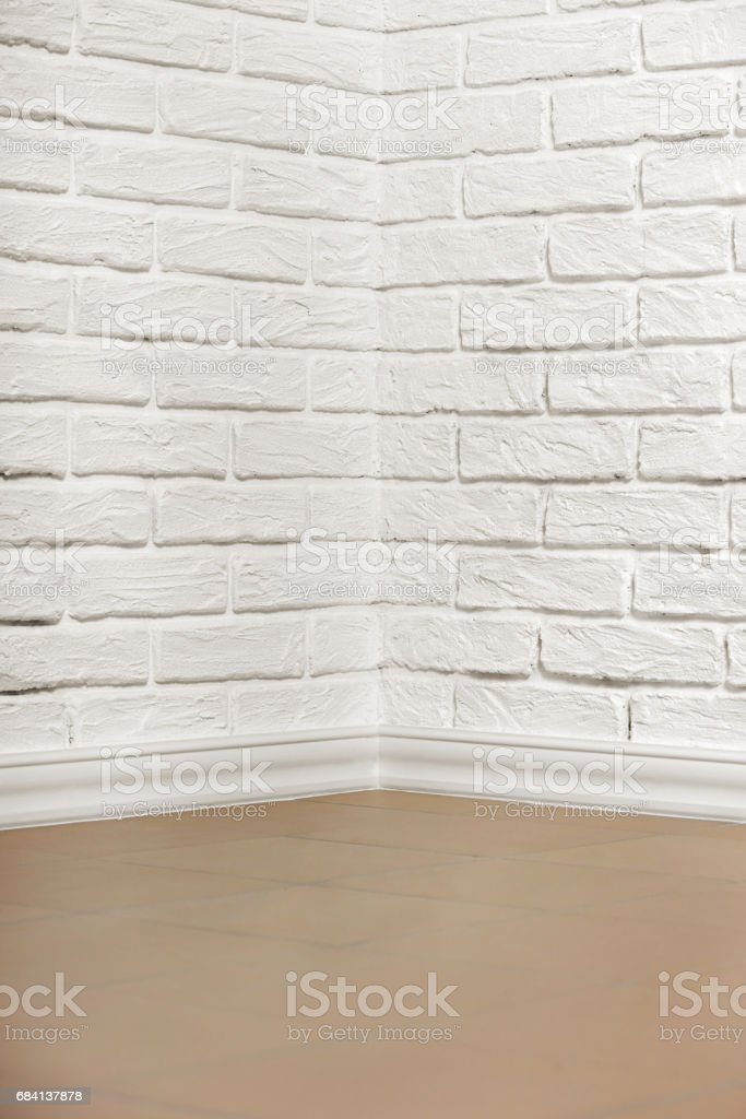 white brick wall with tiled floor and corner, abstract background photo zbiór zdjęć royalty-free