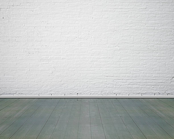 White brick wall with vintage wooden floor indoor stock photo