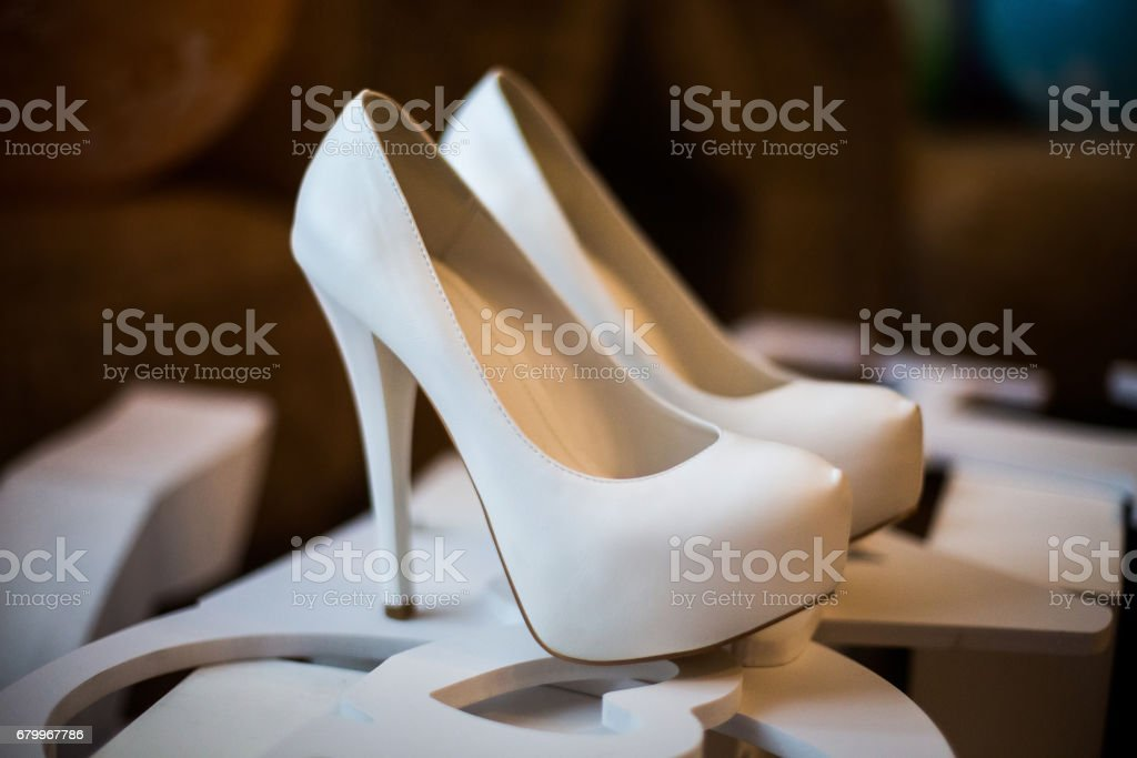 white bridal shoes stock photo