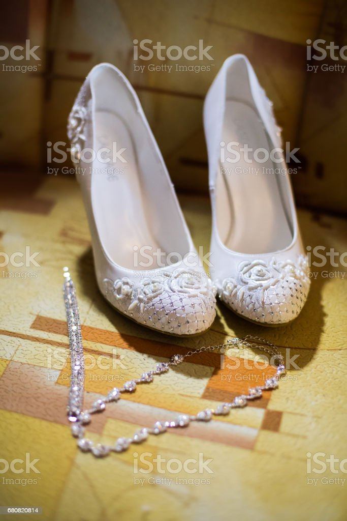 white bridal shoes,bride fees bride morning, ladies shoes, wedding fashion wedding, stylish shoes, chain, wedding jewelery stock photo