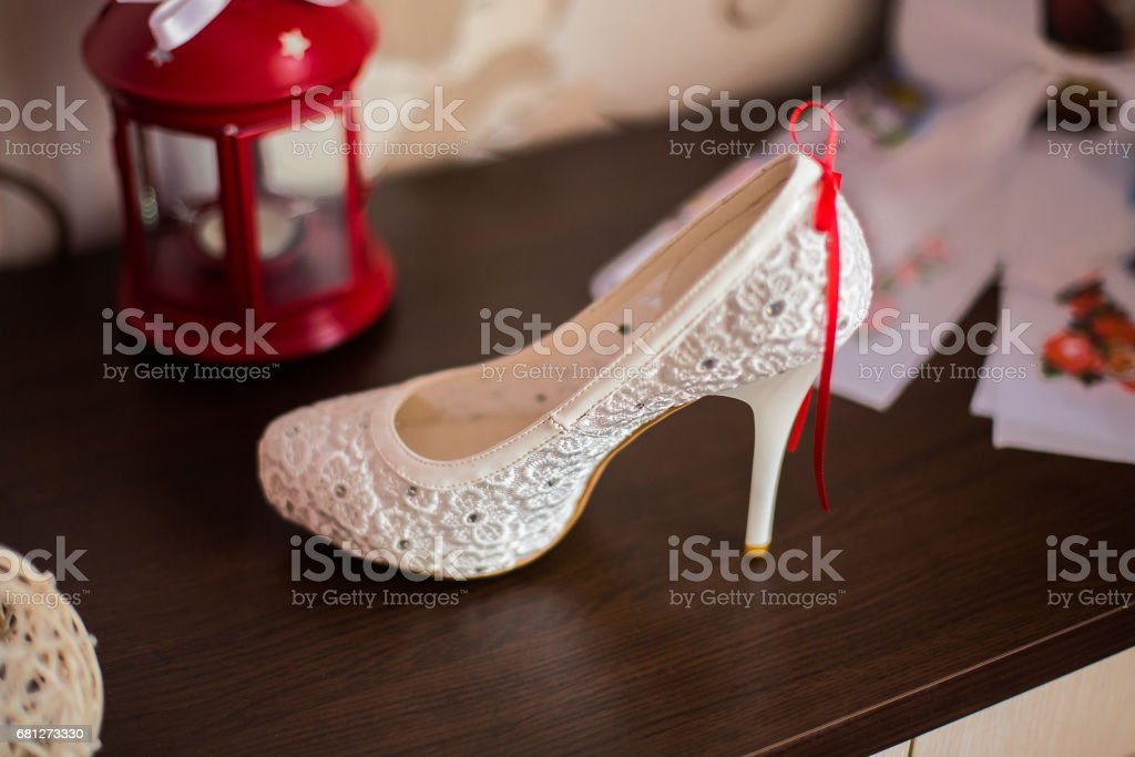 white bridal shoes,bride fees bride morning, ladies shoes, wedding fashion wedding, stylish shoes, stock photo