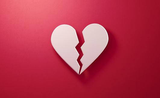White heart shape over red background, Horizontal composition. Valentine's Day concept.