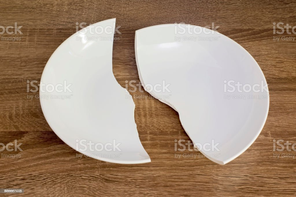 White broken plate on the table stock photo