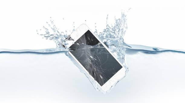 white broken smartphone mock up sinks in water - broken iphone stock photos and pictures
