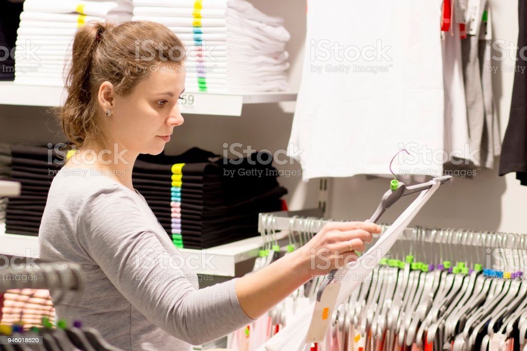 White Brunette Woman Chooses Clothes In Store Sale In Fashion Boutique Dress Up Concept Buy New Clothes In Store Black Friday In Mall Stock Photo Download Image Now Istock