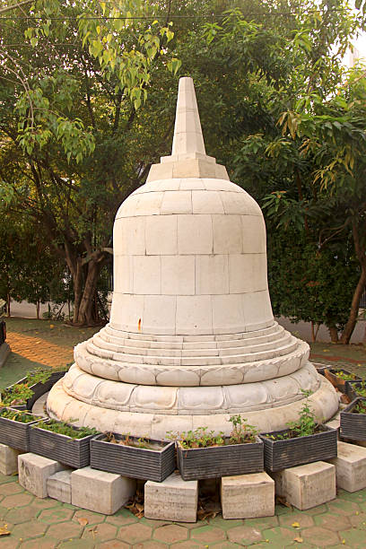 White Buddhist Stupa At Monastery Garden White Buddhist Stupa with Morning Green Environment apothegm stock pictures, royalty-free photos & images