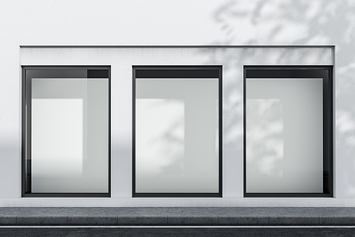 White building exterior with mock up posters