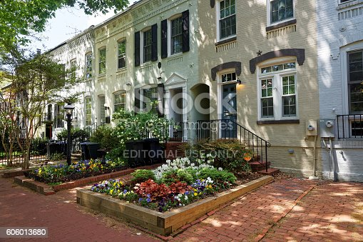 Washington D.C., USA - May 2, 2015: White building pictured in Georgetown district Washington D.C., United States of America. The city was approved by the signing of the Residence Act in 1970 and in 1801 it was organized. City did not belong to any state.