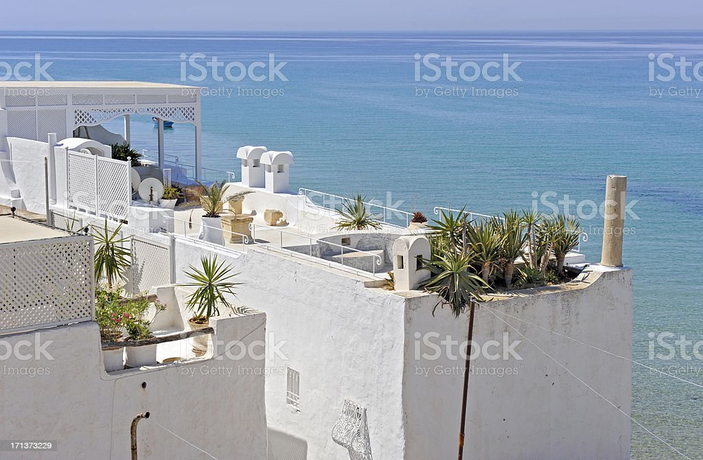 White buildings overlooking the water in Hammamet, Tunisia stock photo