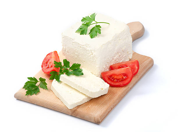 White Bulgarian cheese, arranged with tomatoes and parsley White Bulgarian cheese, arranged with tomatoes and parsley on cutting board feta cheese stock pictures, royalty-free photos & images