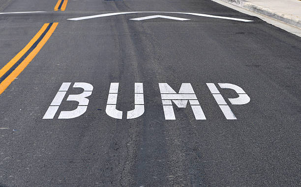 white bump road marking on black tarmac - bumpy stock pictures, royalty-free photos & images