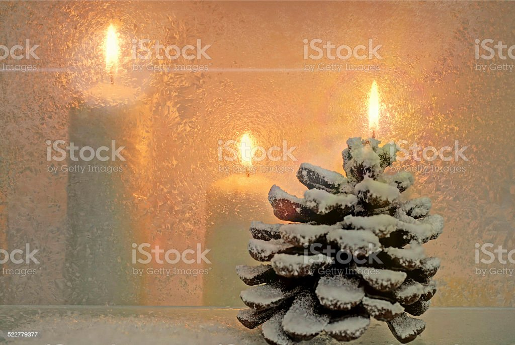 white burning candles and pine cones stock photo