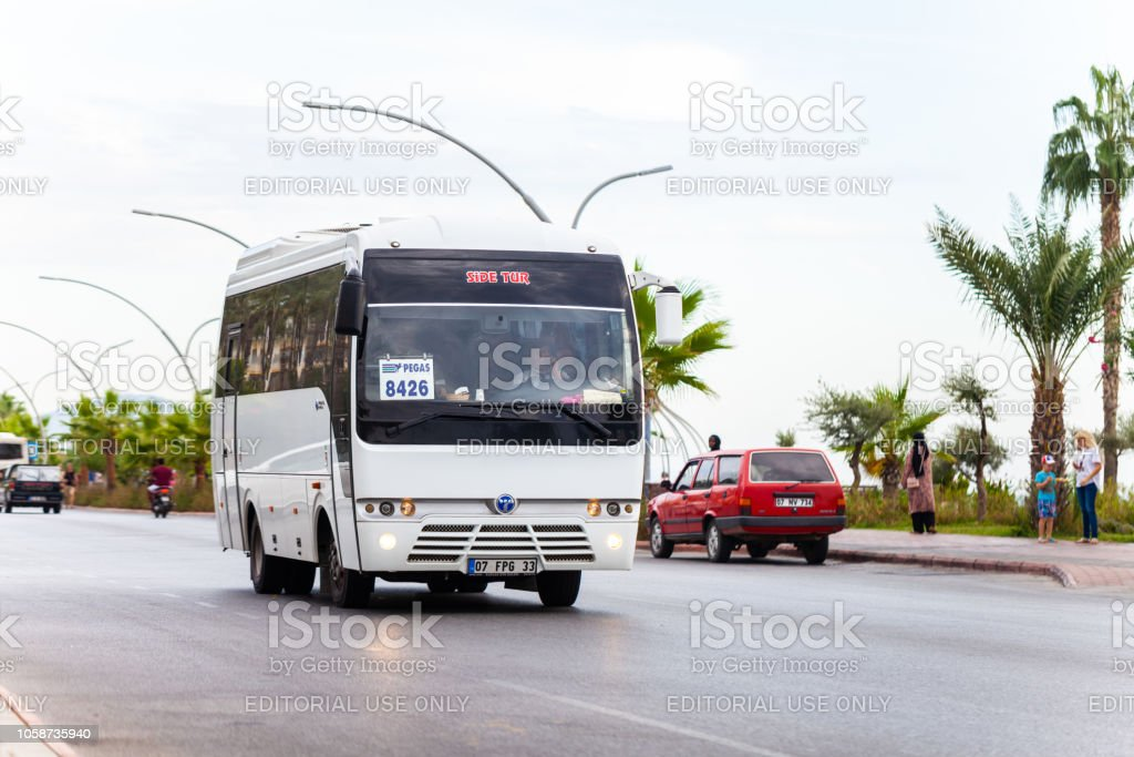 White bus from turkish bus company drives on a street in Alanya