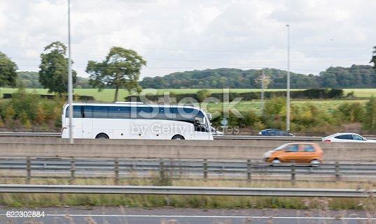1060957508istockphoto White bus on the motorway 622302884