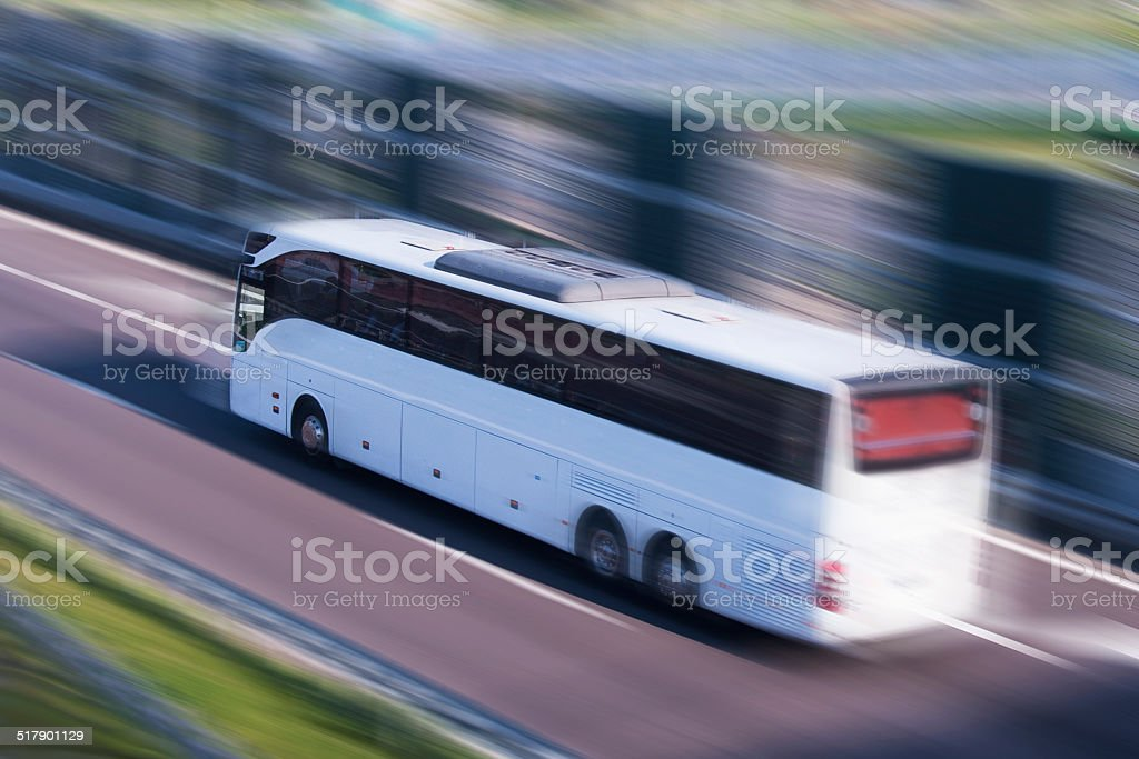 White Bus Running on a Fast Lane, Motion Blur stock photo
