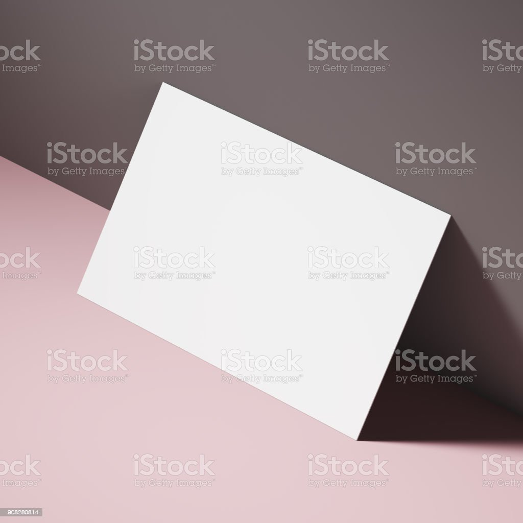 White business card on a pink table stock photo